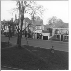 Northern end of the High Street. The large building behind the tree is the post office. The pub to the right is the Yorkshire Grey.   C.A. Hawkes