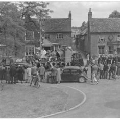 The annual carnival procession passing the Two Diamonds pub in the High Street.   C.A. Hawkes