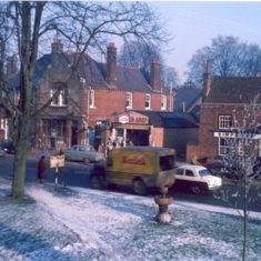 The northern end of the High Street, with the Yorkshire Grey pub on the right, and the post office behind the tree.   C.A. Hawkes
