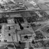 Aerial view of the town centre site before building began, c. 1955