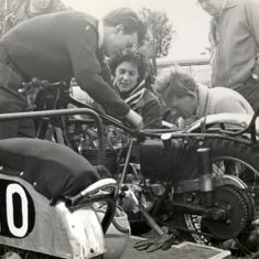 Bike grass-track meeting at Langley in September 1957-59.  Left to right: Unknown, Connie Clark, Peter Clark, Mr Greenshields
