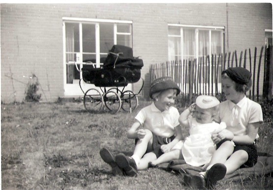 The Hopwood sisters trying on their Mother's hats in the garden in Walden End, Stevenage, May 1960 | Mr & Mrs Hopwood